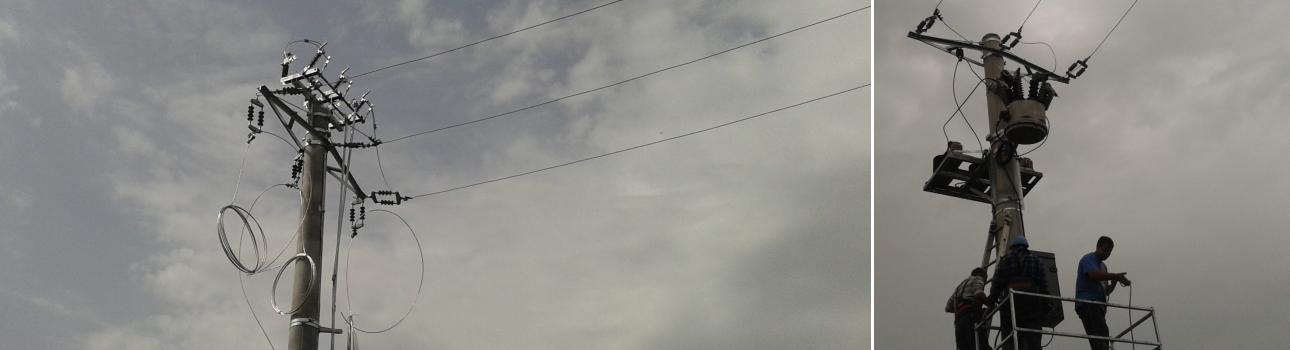 Linie electrica aeriana medie tensiune (stanga) si reanclasator (recloser) telecomandat (dreapta)